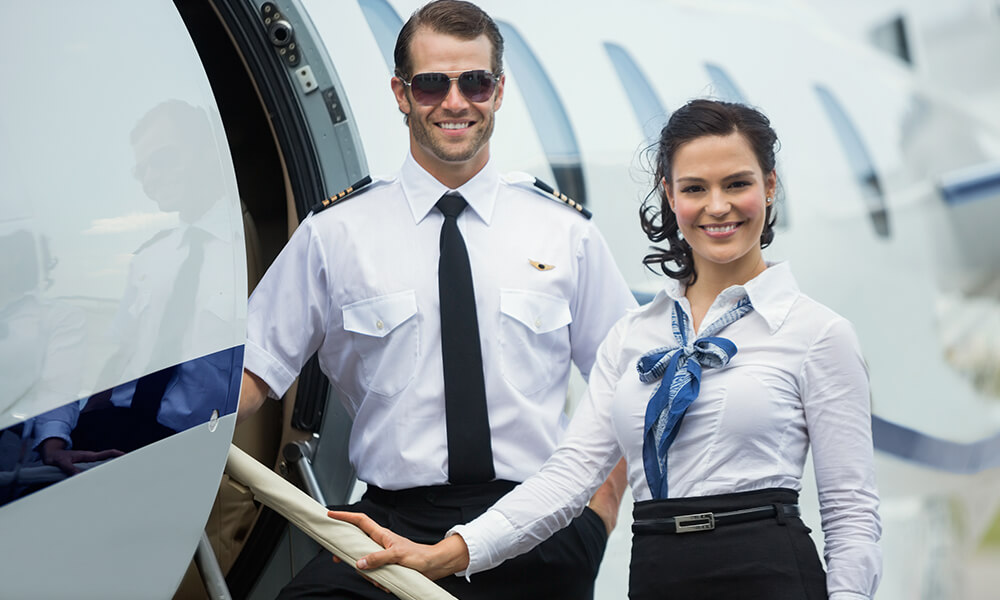 a male and female flight attendand on a charter flight